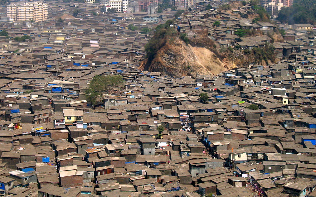 Birds eye view of huge slums - rooves and broken buildings completely covering the city
